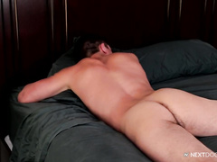 Lovely brunette twinks are passionately fucking on the bed
