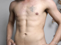 Skinny guy is getting horny while training his body