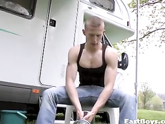 Blonde twink is doing some exercises at woods
