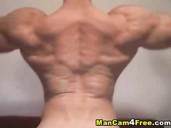 Gay shows his muscles on breast and on back