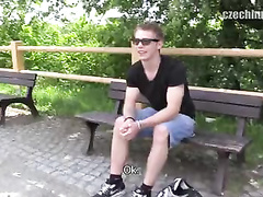 Handsome guy in sexy glasses handjobs stranger's dick outdoors